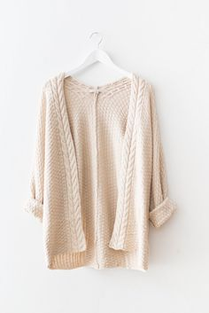 "Cream open knit cable cardigan with braided detailing and long sleeves. Loose slouchy fit. Size S/M measures approx. 30"" in length.  70% Acrylic 30% Polyester I"