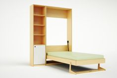 """The Tuck Bed is designed to increase the functionality of a space. It can  be mounted horizontally or vertically to virtually any wall, and folds so  easily and compactly that it can serve as a daily solution for small kids'  rooms. Taking up only 13 3/4"""" of floor space when folded, it leaves plenty  of room for daytime play and even serves as a vehicle for creativity when  ordered with a magnetized panel as the bed's bottom face. An integrated  shelf doubles as leg support, and gaps…"""