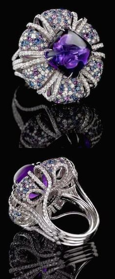 Amethyst ring With a 29 carat cabochon amethyst center stone and a stunning combination of graduated diamonds and amethysts in an original and beautifully crafted mounting this gorgeous ring is a true gem. Google+