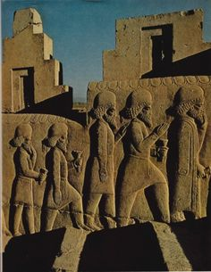 Paying homage to an ancient king, envoys bearing flowers climb a massive staircase amid the ruins of a giant palace at Persepolis. Begun by Darius I in 520B.C., January 1975