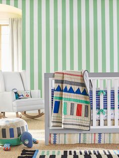 Pick a bold color and mix and match patterns to give your new nursery that extra pop!