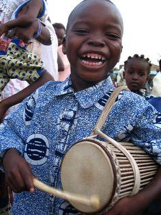 African kid drumming.jpg