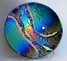 Large Round Abstract Platter in Dark Teal by Karen Ehart. Rivers of dichroic glass in many layers and mosaic-like chips of colorful iridized and dichroic glass flow through this fused and slumped glass platter with gold pen work. Fused Glass Plates, Fused Glass Art, Glass Ceramic, Mosaic Glass, Stained Glass, Slumped Glass, Dichroic Glass, Glass Beads, Sculpture Art