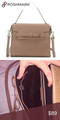 """Ada Ribbon Satchel In Taupe This is a gorgeous and chic purse with a single handle with a detachable shoulder strap. Your items will be secured inside of the bag with a fold over flap. PURSE MEASUREMENTS 30cm {length}x 13cm {width} x 24cm {depth} ••••Approximately 6"""" handle drop /// Detachable shoulder strap approximately 18-23"""" strap drop /// 2 interior pockets Approximately 10"""" H x 12"""" W x 5"""" D /// Both the top handle and the detachable shoulder strap are adjustable•••• Bags Satchels"""