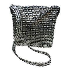 bolso con anillas y cola de rata