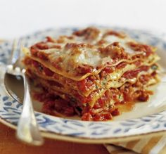 Pinner says - The best lasagna recipe ever. A big hit in my house tonight. I found a very similar recipe that used sliced provolone instead of mozzarella so I used both. I doubled it and ended up w/ enough sauce to make 3. Instead of sweet italian sausage, I used 1 lb mild and 1 lb hot italian sausage and approx 2-1/2 lb ground beef. All else per the recipe.