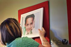 buy a frame to exactly match the size of picture, cover board with fabric to match decor.  Mount.  Great idea!