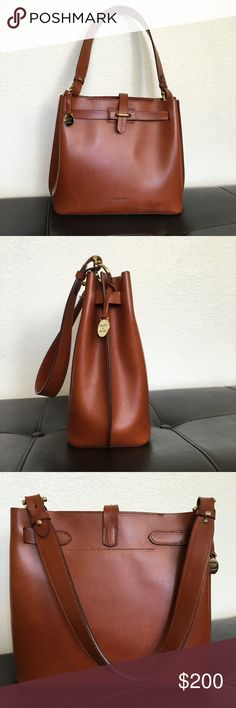 Dooney & Burke handbag Dooney & Burke all leather handbag. Great condition like new. No stains, marks, or scratches of any kind. Ordered this bag directly from Dooney & Burke. One inside zip pocket. Dooney & Bourke Bags Totes