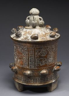 "This is a classic Mayan chocolate pot used in feasts sponsored by the ruling elite. This is at the Walters Art Museum in the special exhibition ""Exploring Art of the Ancient Americas: The John Bourne Collection Gift."" http://art.thewalters.org/detail/80194/lidded-vessel/"