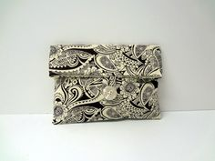 This Adorable Clutch / Makeup Bag is made from a brown and cream print fabric. Its Lined in a solid cream and has a cream button. The foldover buttoned makeup bags are made from quality cotton designer fabrics. The medium size is approximately 8x6 inches and they are adorned with a