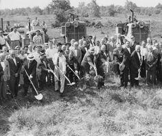 Crowd of people shoveling dirt at a ground breaking ceremony, May Co. N.L. Dauby, David Geller, James Day, Francis Coy, Sam Miller, Arther Began Mayor Joseph Kader, and Sam Rosenberg. 1959
