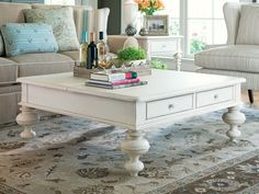 square shabby chic coffee table with gustavan style drawers.  don't sweat the white, we can repaint it.
