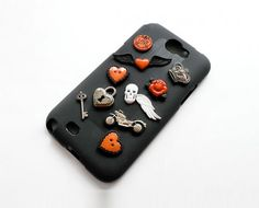 Today's Hot Pick :Embellished Halloween Skull Phone Case http://fashionstylep.com/P0000OOC/chuukr/out Give your phone some punk rock love with this edgy phone case. It is a black case covered in embellishments in the shape of hearts, padlock, key, rose, crown, motorcycle and skull. All these details make up a Halloween sort of theme in orange and black. -Matte case -Heart shape -Heart padlock -Key -Skull -Rose -Crown -Trinkets