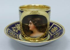 ROYAL VIENNA PORTRAIT CUP AND SAUCER