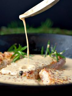 INGREDIENTS     4 boneless pork chops   3 cloves garlic, minced   1-2 sprigs fresh rosemary, minced   3/4 cup apple cider   1/3 cup heavy cream   2 tablespoons butter   1 tablespoon wholegrain Dijon mustard   Kosher salt and freshly ground