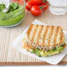 This healthy sandwich makes for a SUPER satisfying lunch! Turkey, pesto, & fresh tomatoes with melty cheese on toasty whole grain bread.