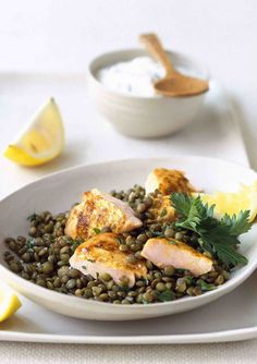 Try this interesting twist on classic grilled salmon. Spiced with garam masala and served with garlic and lemon Puy lentils, this is a healthy mid-week supper.