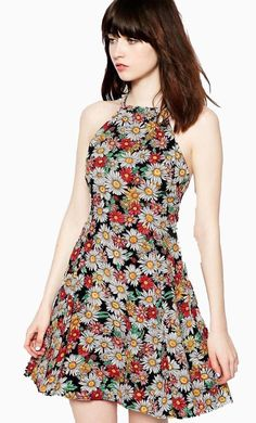 Made from a soft woven fabric. High neckline. Halterneck design. Floral print. Regular fit. Fabric: 10...