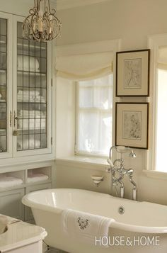 Charbonneau designed the built-in cabinets as storage for linens, recycling old leaded windows from elsewhere in the house to create the doors. An off-white palette and an antique chandelier complete the look.