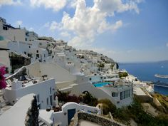 Towering volcanic cliffs and white-washed buildings above the crystal clear Mediterranean makes Santorini a picture of perfection. Learn more about this beautiful island here: http://jumpedthenest.com/postcards-from-santorini/