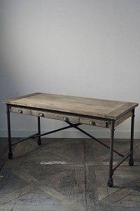 Industrial-ish desk, wood floor, grey wall. (Driftwood Industrial Office Desk)