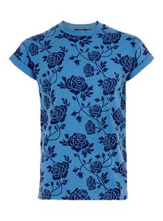 Time to man up and embrace the florals this summer. Blue rose print with high roll sleeves from Topman