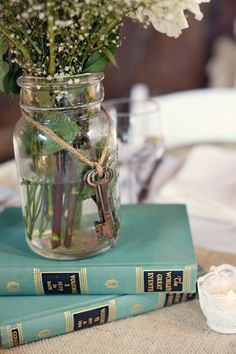 the original pin was for the pretty books - i like the flowers in the jar tho =]
