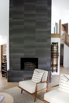 Concrete tile floor to ceiling fireplace is a show stopper in this modern casual family room Painted Brick Fireplaces, Shiplap Fireplace, Home Fireplace, Modern Fireplace, Fireplace Design, Fireplace Ideas, Industrial Fireplaces, Fireplace Remodel, Casual Family Rooms