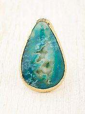 super attracted to the blue green colors on the stone of this ring.