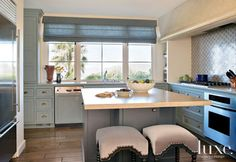 Gray Transitional Kitchen with Blue Cabinetry
