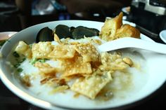 Bubur telur phitan. (Phitan Egg Pouridge)