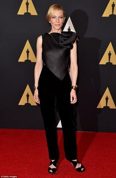 Style: Cate Blanchette stunned in a black top and trousers as she posed on the red carpet ...