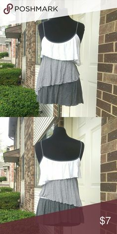 3 tier top Stretch top in excellent condition. Elegant. Very pretty and soft. Cute sideways cut. Perfect for any occasion. Say What? Tops Tank Tops