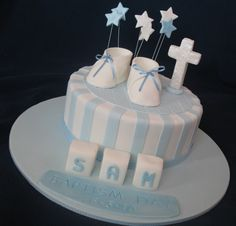 A single tiered Christening cake to celebrate this wonderful milestone in little Sam's Christian life. Little booties, stars and cross sat a...