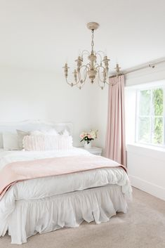 Pink bedroom with chandelier and dusty rose drapes
