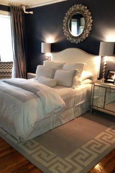 The place where the shades hit the corners of the headboard cause the light to arch just so, framing the bed and highlighting the mirror.