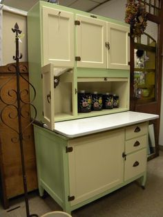 Green and cream Hoosier cabinet.