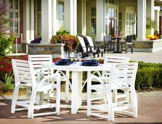 "CRP St. Tropez Dining Arm Chair and St. Tropez 39"" Dining Table.  Available in 16 colors."
