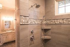 Shower: Tile: Angora, Amelia, 12x24, Smoke; Shower Accent: Tile, Baroque, 2x2, Gris ET Blanc Glass; Backsplash Border: Angora, Amelia, 3x12, Smoke