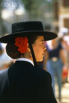 Woman wearing traditional hat of Spain.