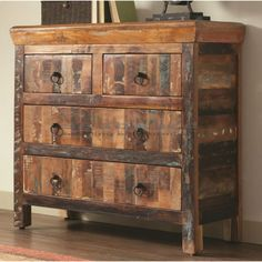 Get additional storage in your living room with the Coaster Rustic 4 Drawer Reclaimed Wood Accent Cabinet 950366. With two large and two small drawers, you have ample space to store those extra things you can't find a home for. Constructed with reclaimed wood of acacia and teak, the finish is natural creating a beautiful unique piece. The metal ring pulls complement the rustic look of the cabinet.