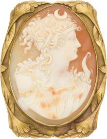 Shell Cameo, Gold Pendant-Brooch The pendant-brooch features an oval-shaped shell cameo measuring 60.00 x 45.00 mm, depicting a Greek goddess, resting within a 14k yellow gold frame. A retractable bail, pinstem and catch complete the reverse. Gross weight 33.90 grams.