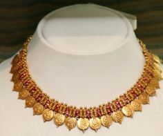 Contemporary jewellery designs from NATHELA jewellers..      Its a unique kind of ruby pendent along with ear rings..          Its an an...