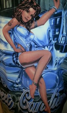 Cruizin Low XL sexy tattoo Sweet Candies low rider shirt  Beautiful sexy lady with tattoos smiles from in front of an awesome  Low Rider Auto.  Sweet Candies printed along bottom.  Same image on shirt back.