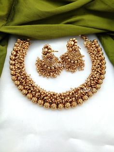 Trendy Designer Plain Antique Gold Bead Necklace along with matching Earrings. The matt finish on the necklace gives an auspicious look. Indian Wedding Jewelry, Wedding Jewelry Sets, Indian Jewelry, Indian Bridal, Bridal Jewelry, Gold Earrings Designs, Gold Jewellery Design, Gold Jewelry, Necklace Designs