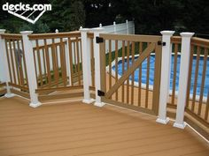 Pool Deck Gate Ideas accents saddle wood deck with lighting and gate traditional patio I Would Need To Have A Gate On My Pool Deck