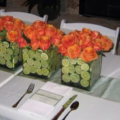Table Centerpieces square glass with cut limes and orange roses
