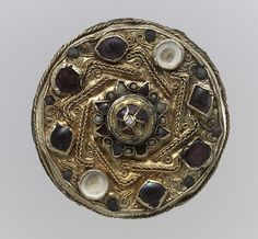 Frankish Disk Brooch, Gold sheet with filigree and inlays of garnet, glass, and mother-of-pearl, c. 675 - 700. Found in Niederbreisig, Germany
