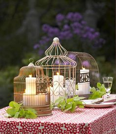 Birdcages are just like the bird's nests we talked about, a creative and unique rustic centerpiece that can be filled with anything! If you really want to go all out with the rustic feel of your birdcage fill it with moss, twigs, little birds, or even an owl! You could also keep it simple like the idea in the photo with just a few candles and still have the rustic touch you are going for.