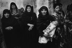 EGYPT. Deir El-Adra. 1997. Church of Sta Helena. Orthodox Copt (Egyptian Christian Church) women attend the Friday mass (traditionally a Muslim holy day). photo by Abbas